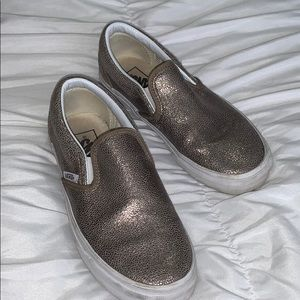Metallic gold Vans slip ons